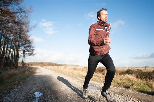 Man running on gravel road